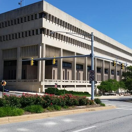 Investigate and find the source of a leak outside the Baltimore County Circuit Court building