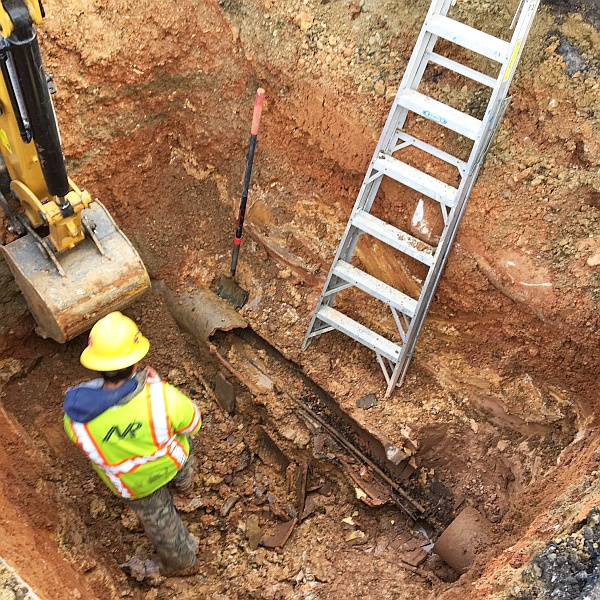 Repair a sinkhole at Baltimore City Schools - identify the plumbing problem, excavate the area and locate the collapsed storm drain line